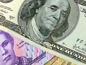 Отставка Азарова помогла спасти гривну от девальвации